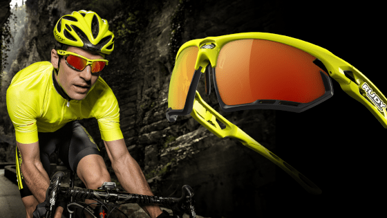 Rudy Project sports glasses for cycling with orange mirrored lenses and a yellow-black frame