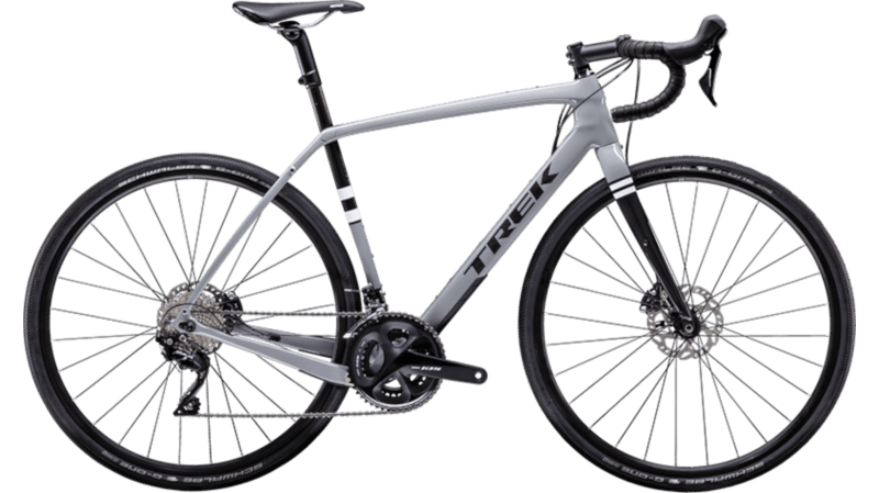 Gravel-bike of the company Trek with seat tube suspension in carbon frame. Disc brakes and color grey with white and black